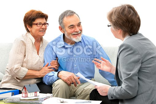 466848706 istock photo Two happy people sitting across from a real estate agent 470221685