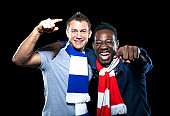 istock Two happy rival sports fans 160532094