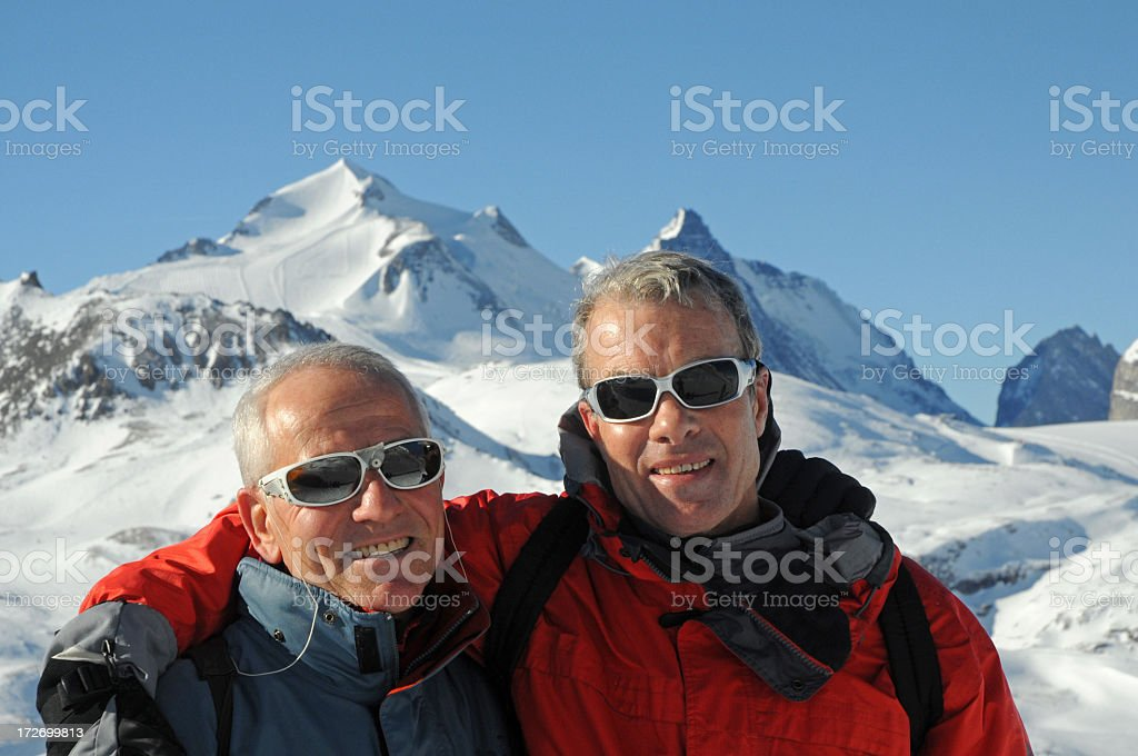 Two happy senior friends on the ski slope royalty-free stock photo