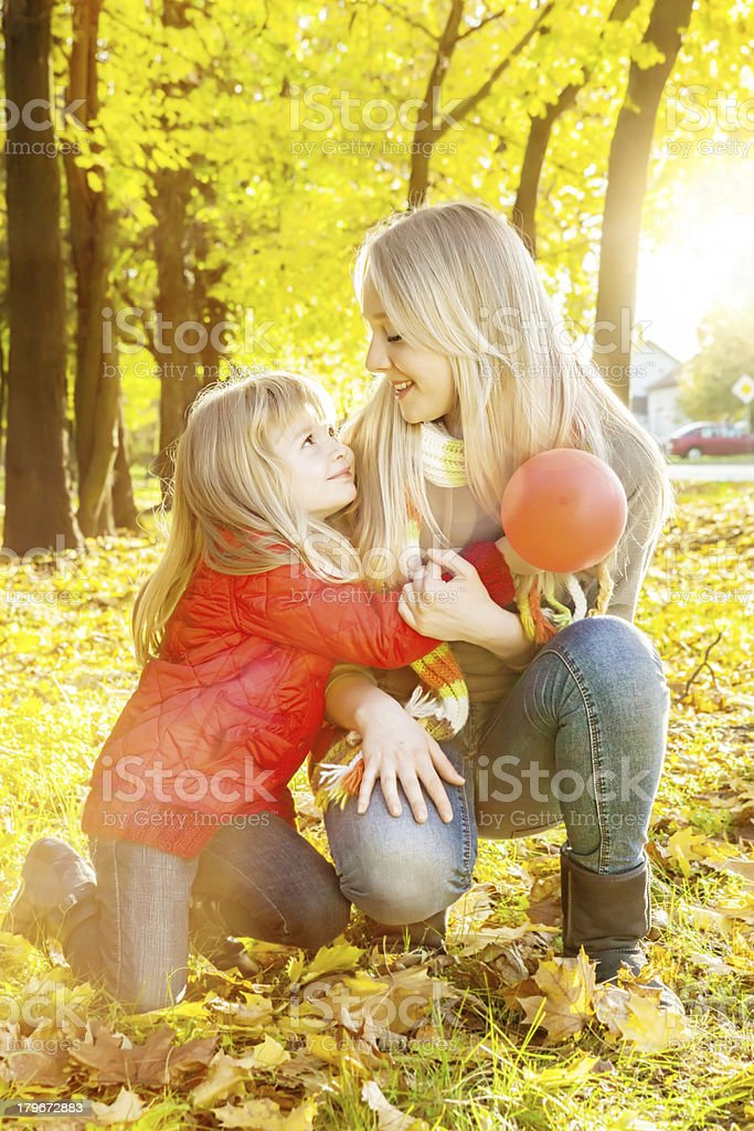 Two happy sisters smiling and hugging outdoors royalty-free stock photo