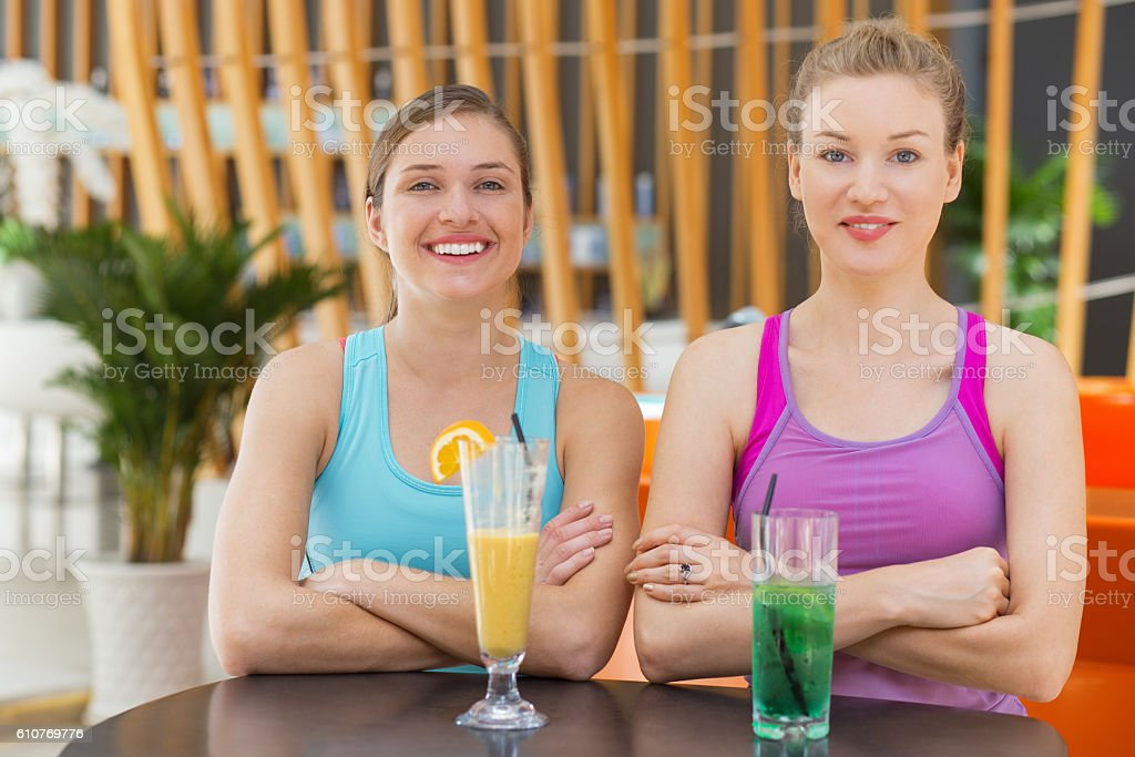 Two Happy Sporty Women Sitting in Fitness Cafe stock photo