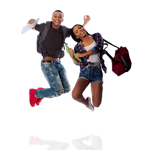 two happy students jumping of happiness - african youth jumping for joy stock photos and pictures