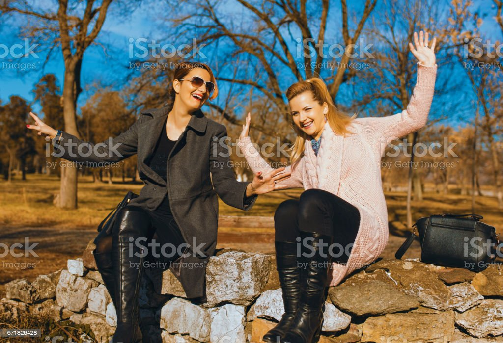 Two happy woman friends laughing stock photo