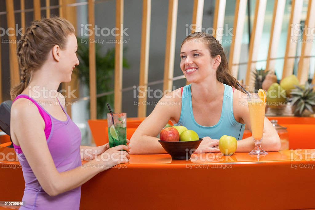 Two Happy Women Chatting at Sport Bar Counter stock photo