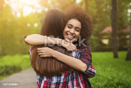 Bff long-awaited meeting. Happy girls hug in park after long separation, copy space