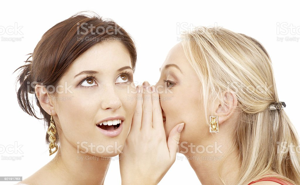 two happy young women gossiping stock photo