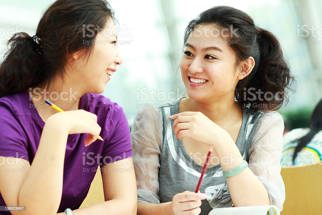 two happy young women having nice conversation royalty-free stock photo