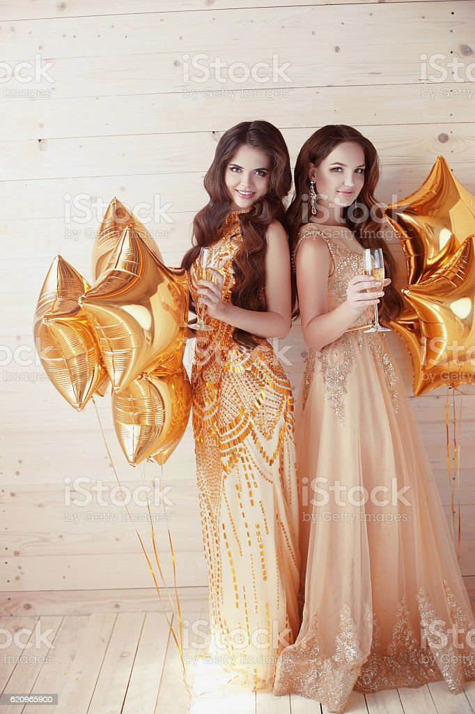 Two happy young women on party with glasses of champagne. - foto de stock