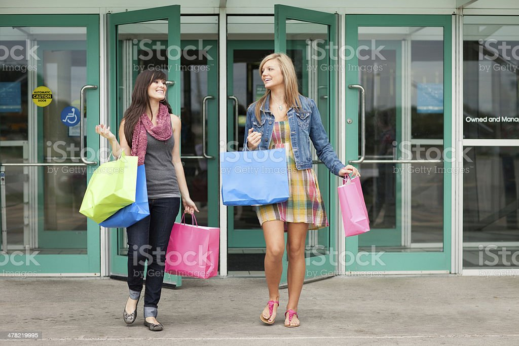 Two Happy Young Women with Shopping Bags at Mall royalty-free stock photo