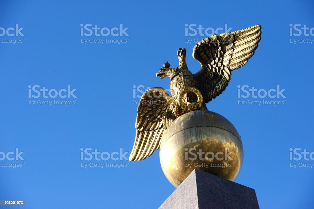 Two headed golden eagle obelisk in the market square Helsinki Finland stock photo