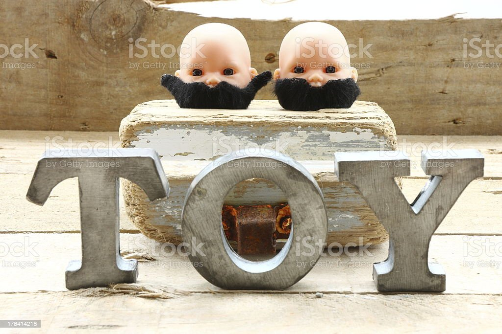 Two heads and toy royalty-free stock photo
