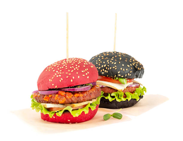 Two healthy vegan burgers on a paper isolated on white background