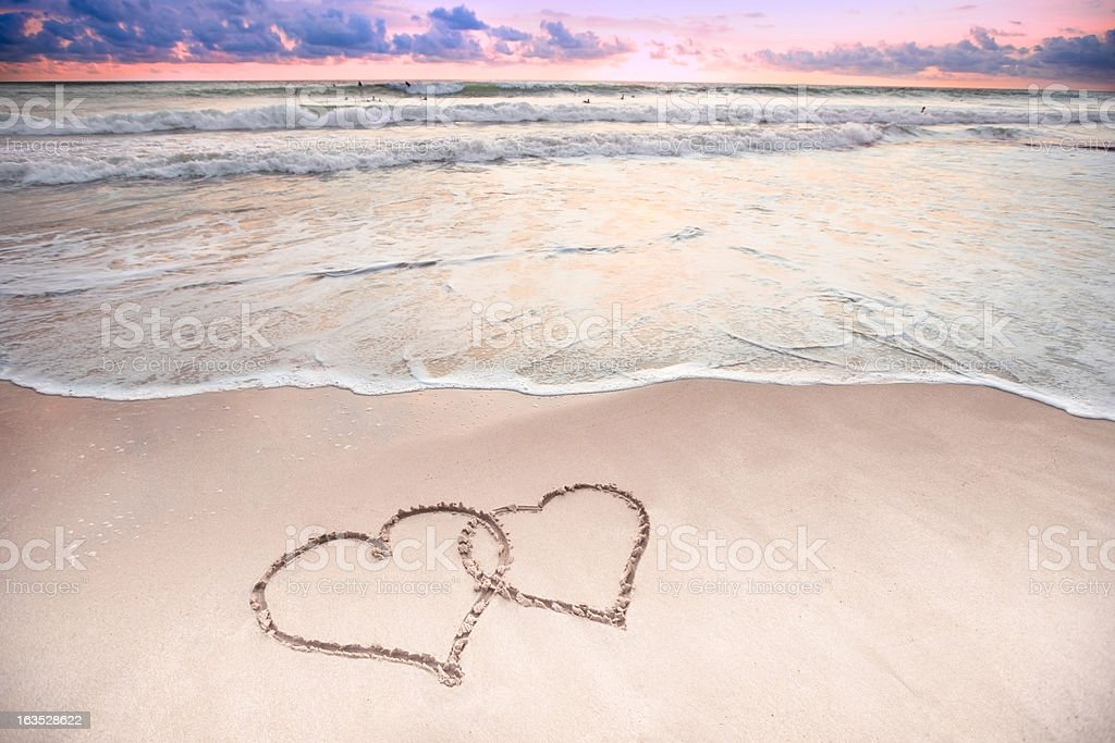 Two Hearts at the beach stock photo