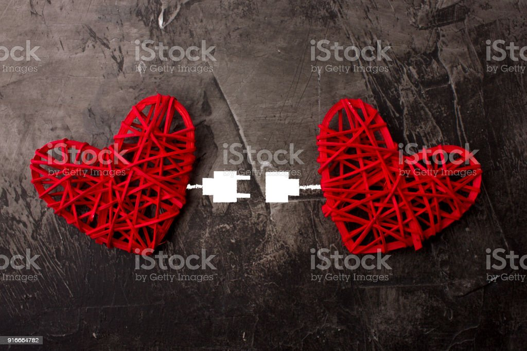 Two hearts connected by USB cable. Theme of love, wedding, Valentine's Day stock photo