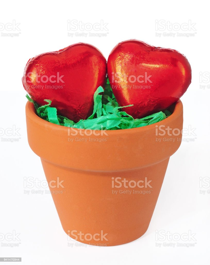 two hearts in clay pot stock photo