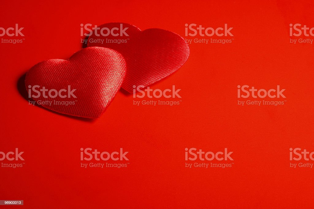 Two hearts in the corner. royalty-free stock photo