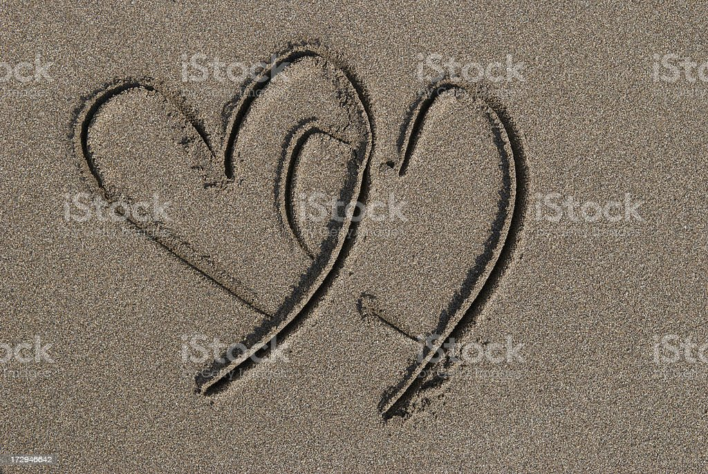 Two Hearts in the Sand stock photo