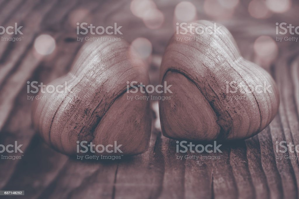 Two hearts of wood in sepia stock photo