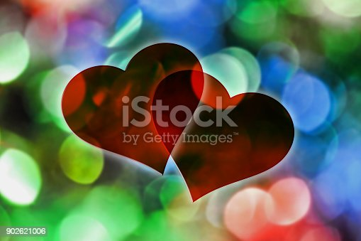 istock Two hearts on a colorful defocused lights background 902621006