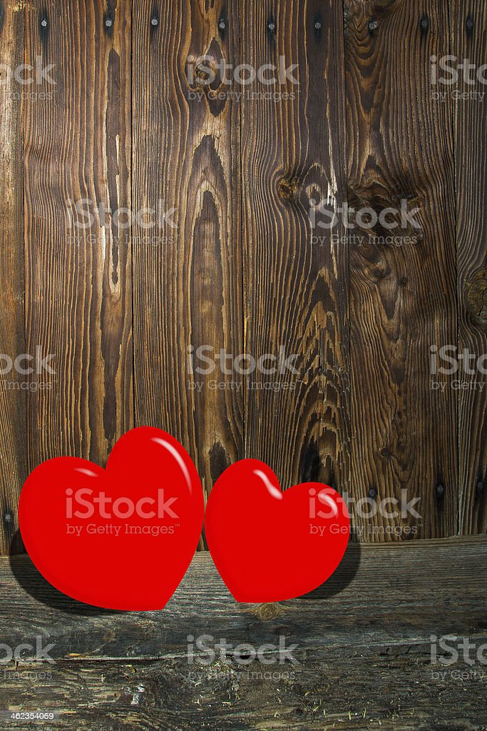 Two hearts on a wooden scene stock photo