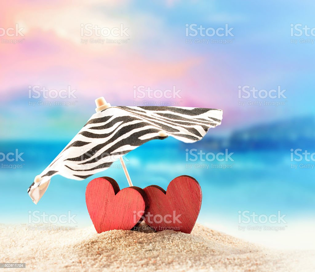 Two hearts on the summer beach stock photo