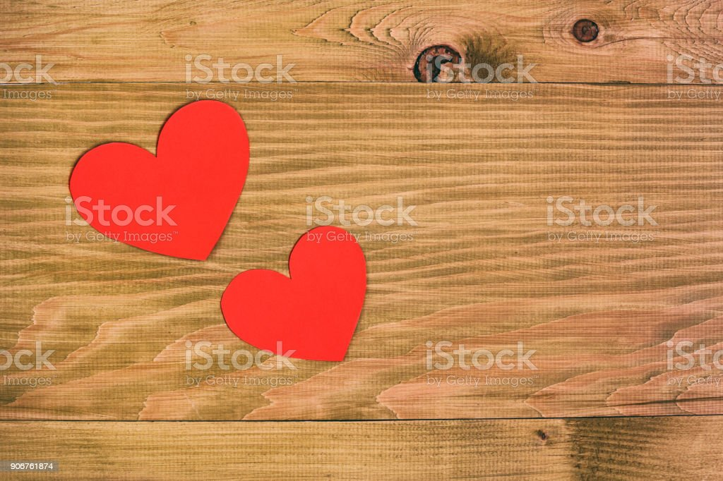 Two hearts on wooden table stock photo