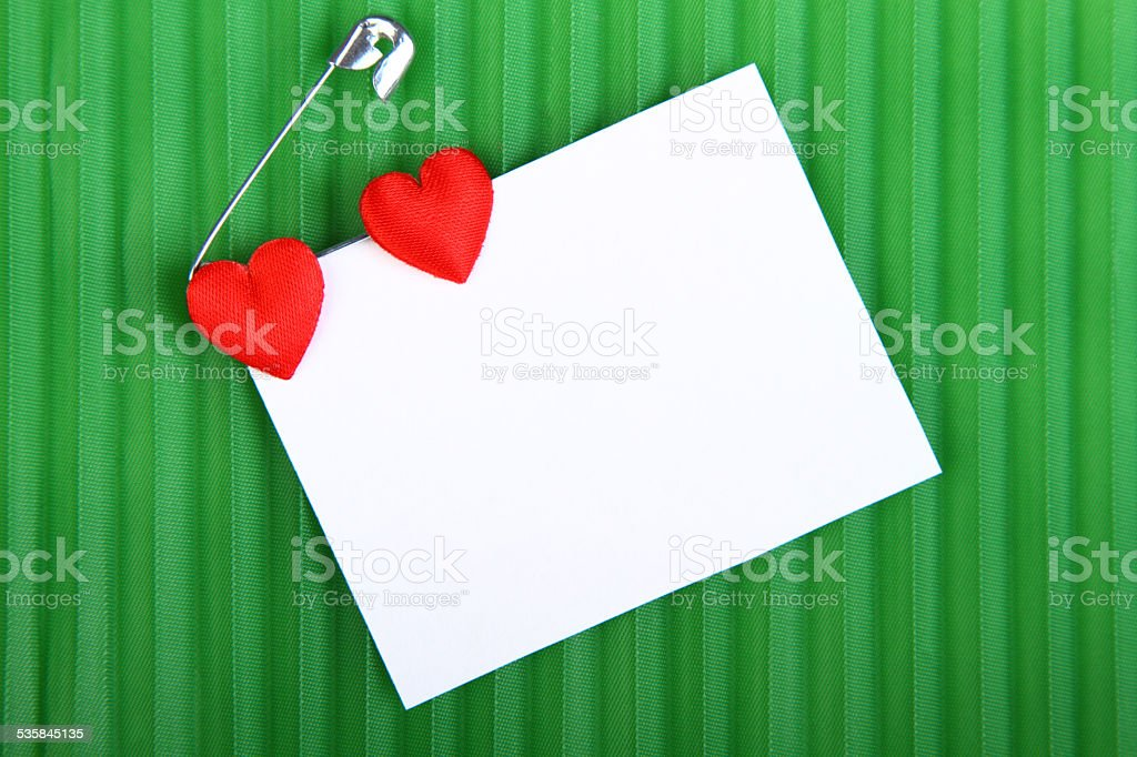 Two hearts with a card to a message stock photo