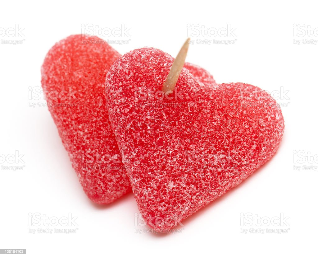 two heart-shaped candies atached to each other with a toothpick royalty-free stock photo