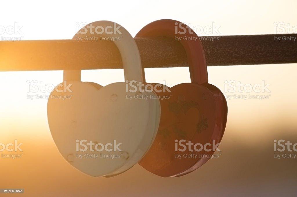 two heart-shaped padlocks stock photo