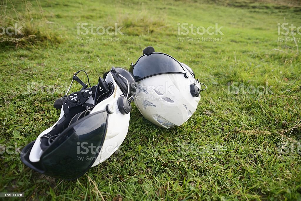 Two Helicopter Crew Helmets on the Grass royalty-free stock photo