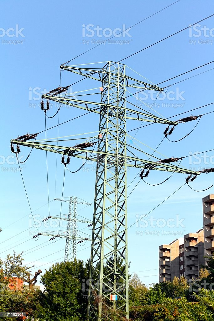 Two high voltage towers in the city royalty-free stock photo