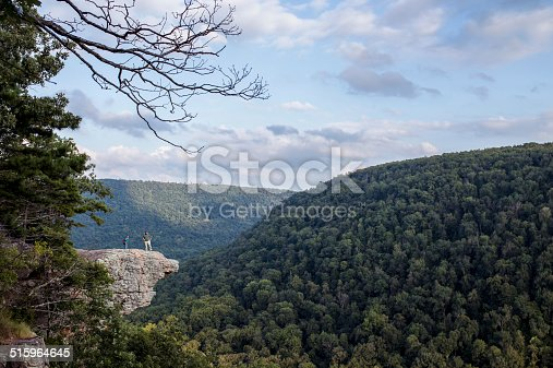 Two hikers stop to take in the view at Whitaker Point, also known as Hawksbill Crag