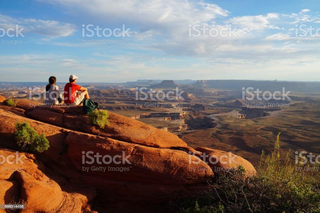 Two hikers enjoy the view form the Green River Overview stock photo