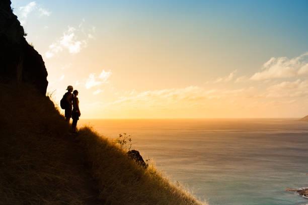 Two hikers enjoying beautiful view stock photo