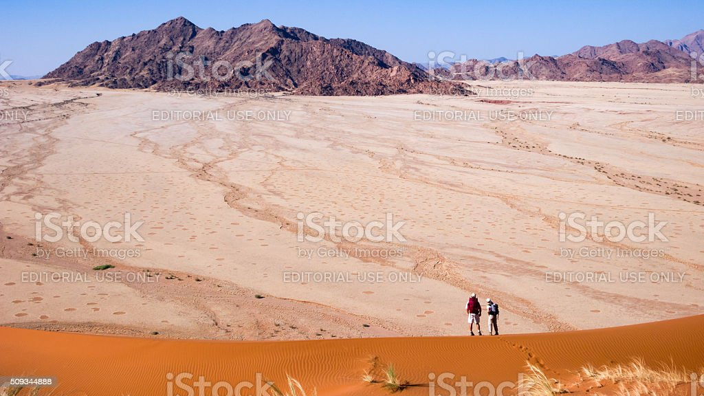 Two Hikers on a dune in Namibia stock photo
