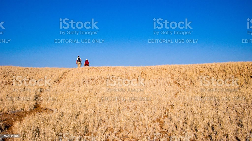 Two Hikers on a prairie hill stock photo