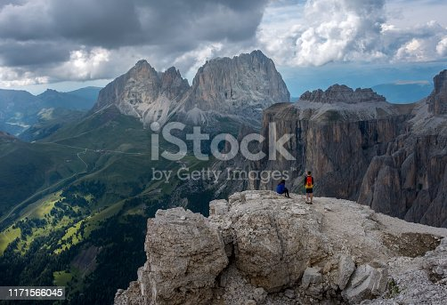 Two hikers taking a rest on top of Sass Pordoi in the Italian Dolomite mountains, Monday 11 August 2018, Arabba, Italy.