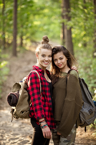 Two Hipster Girls Standing In The Forest Stock Photo - Download Image Now