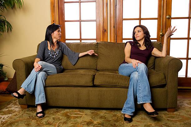 Two hispanic women arguing stock photo