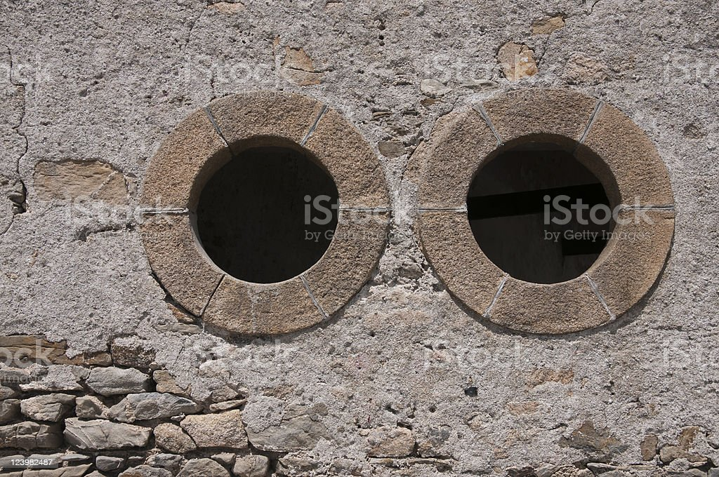 Two holes in a old wall.