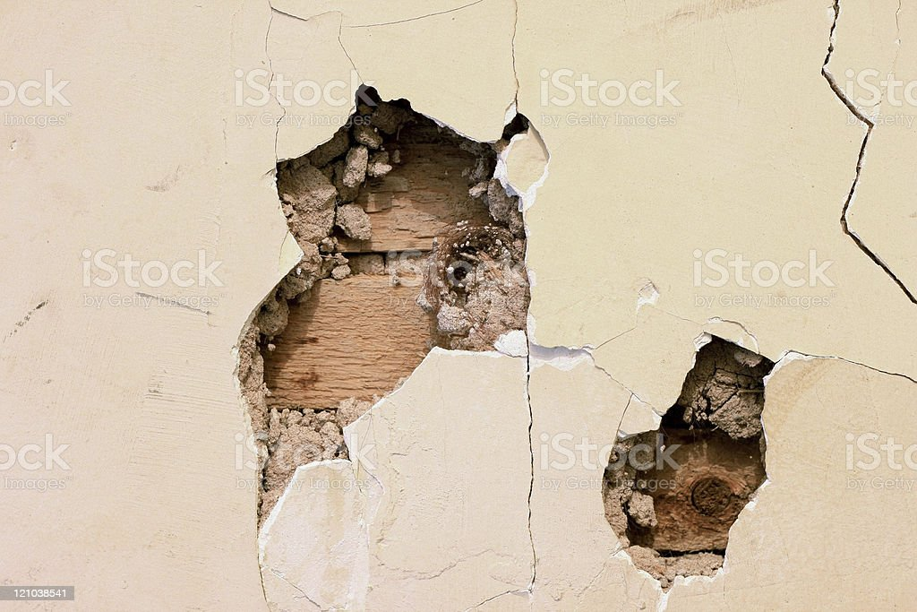 Two Holes in Plaster Wall stock photo