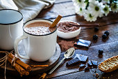 istock Two homemade hot chocolate mugs on rustic wooden table 872026888