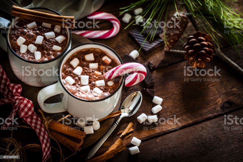 Two homemade hot chocolate mugs with marshmallows on rustic wooden Christmas table stock photo