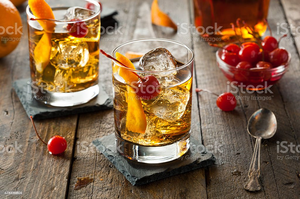 Two homemade old fashioned cocktails with cherries stock photo