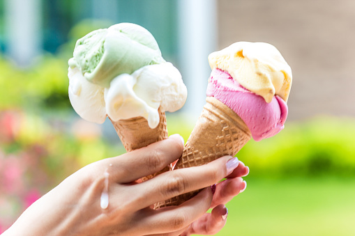 Two Horns With Ice Cream In Hot Weather In A Girls Hand Stock Photo - Download Image Now