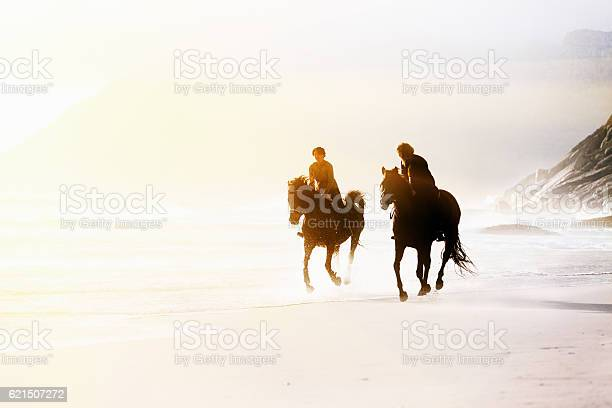 Two horseback riders galloping on wild windswept beach picture id621507272?b=1&k=6&m=621507272&s=612x612&h=0qhp4xe11fijoxllzbss 311bv eyr68mmknuyvzyfq=
