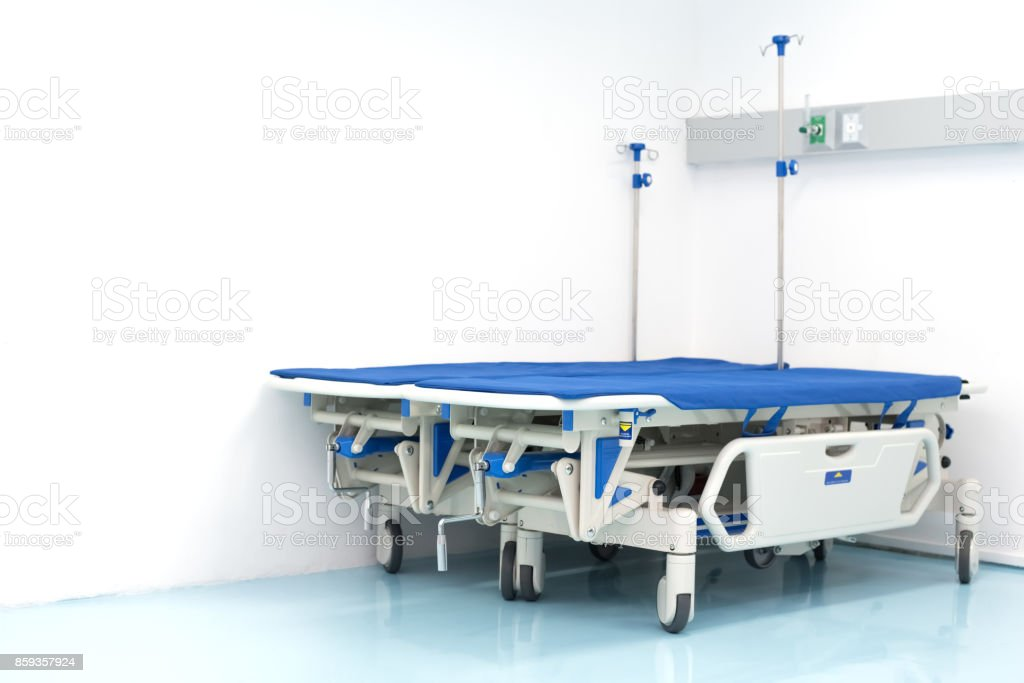 Two hospital bed on the room corner. Hospital and emergency room...