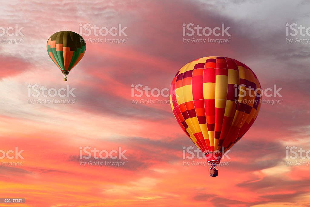 Two Hot Air Balloons Ascending in A Beautiful Sunrise stock photo