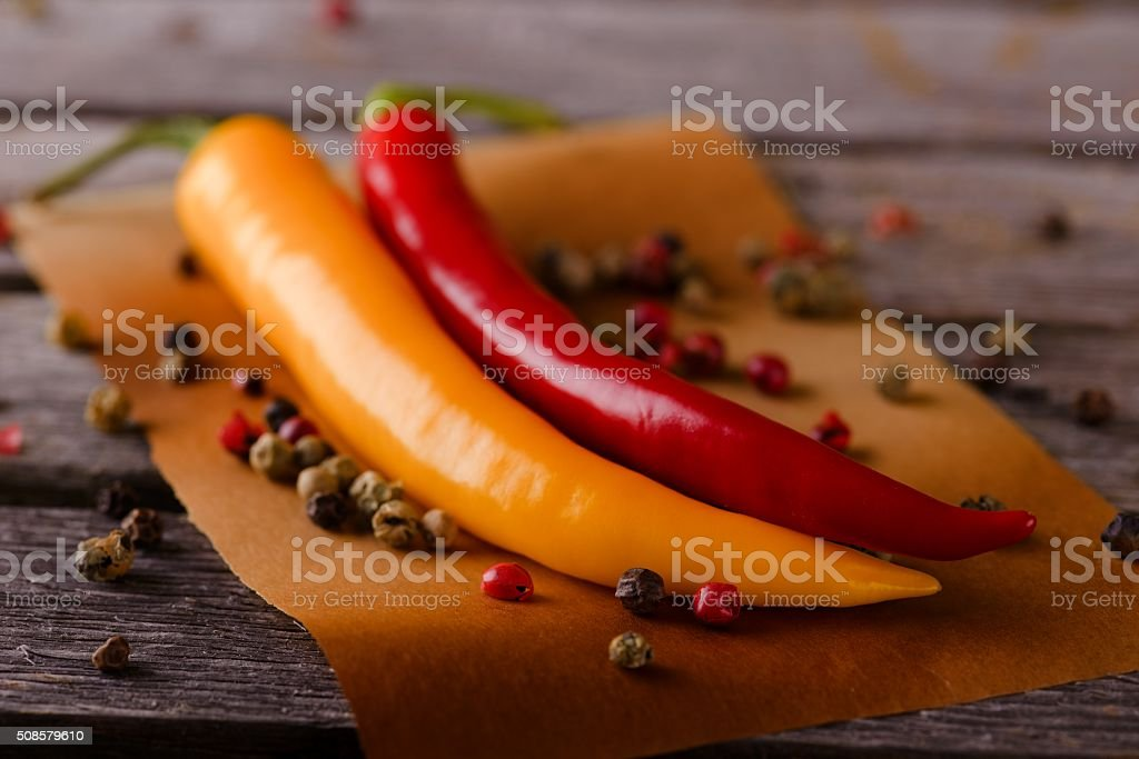 Two hot chili peppers with pepper seeds stock photo