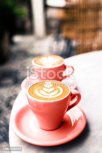 1078505838 istock photo Two hot cups of latte coffee on marble table background. 1080129122